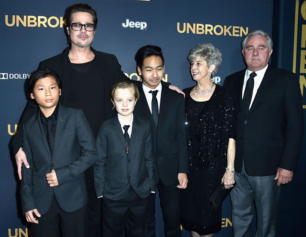 """Brad Pitt with children Pax, Shiloh and Maddox Jolie-Pitt, and his parents Jane, and William Pitt the premiere of """"Unbroken"""" in 2014 in Hollywood 