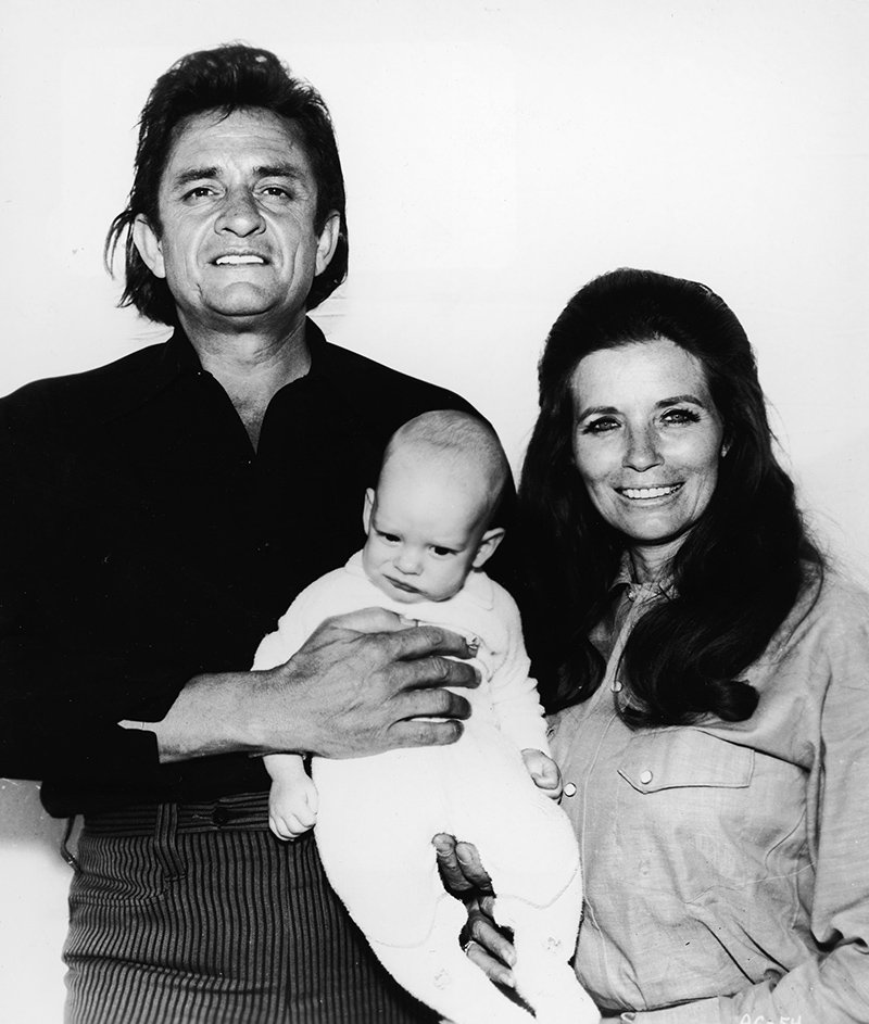 Johnny Cash, his wife June Carter, and their son John. I Image: Getty Images.