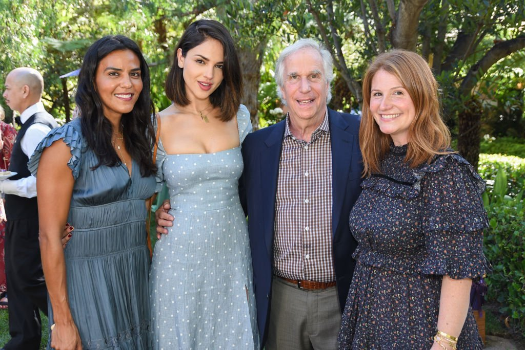 Elsa Collins, Eliza Gonzalez, Henry Winkler, and Zoe Winkler attend a high tea event. | Source:Getty Images