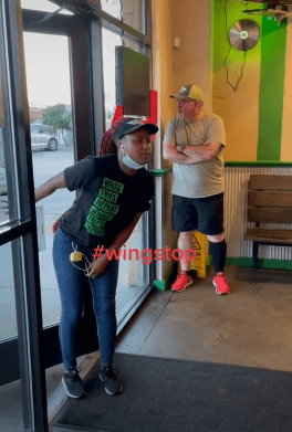 Woman standing by the door while yelling   Photo: TikTok / 421speed