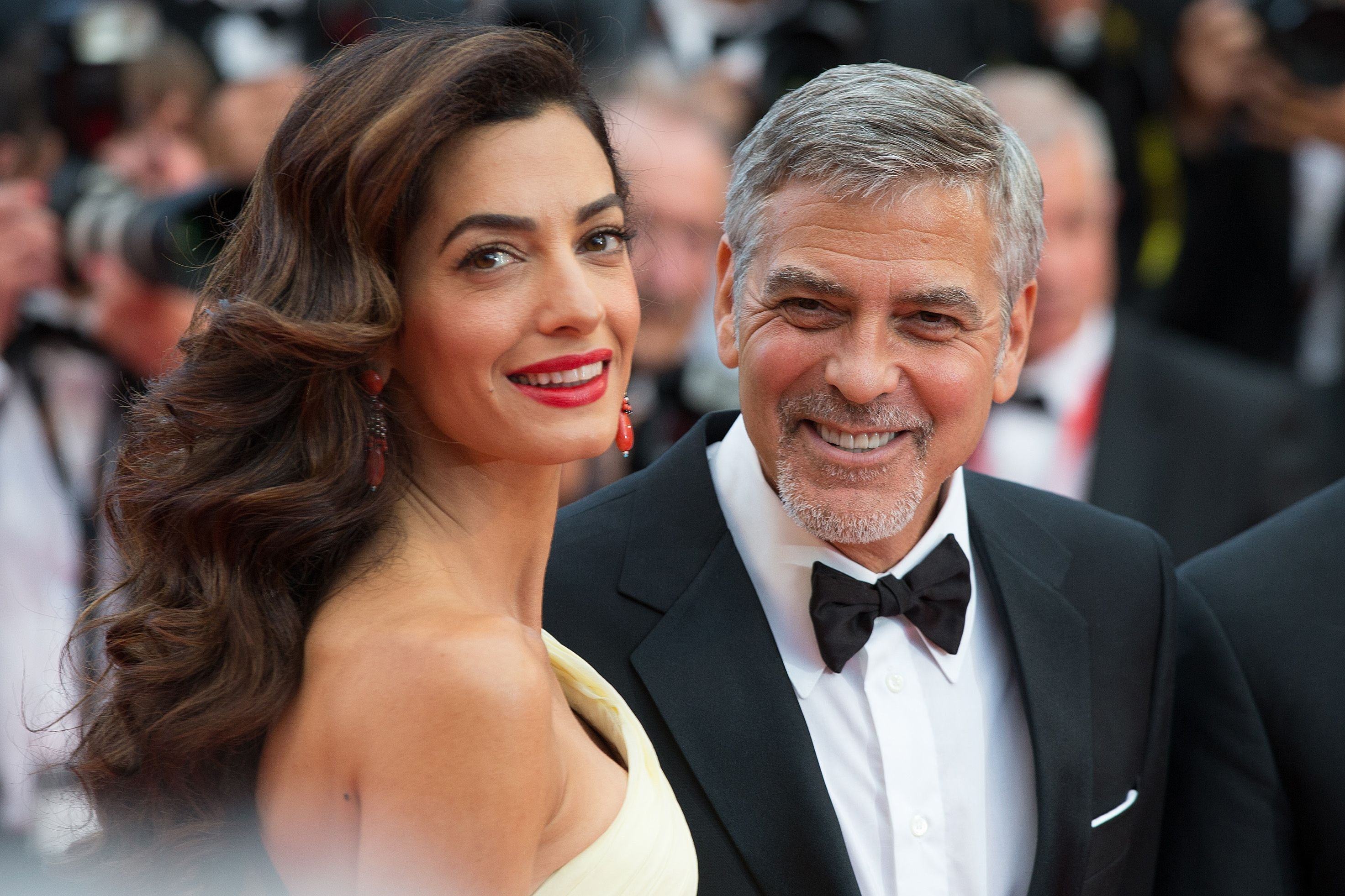 "George and Amal Clooney at the 2016 Cannes Film Festival for the screening of ""Money Monster."" 