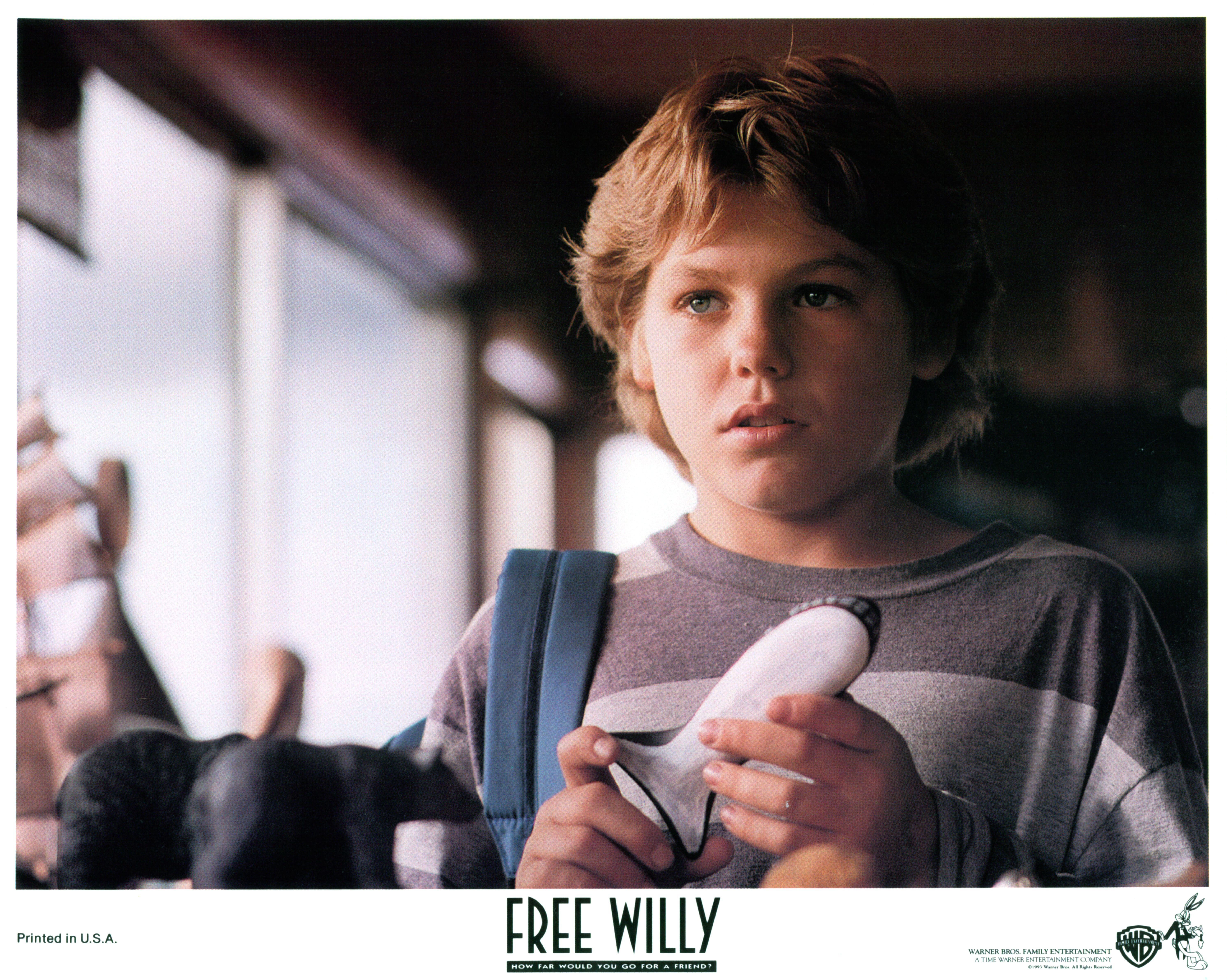 """Jason James Richter holding whale piece in a scene from the film """"Free Willy"""" in 1993.   Source: Getty Images"""
