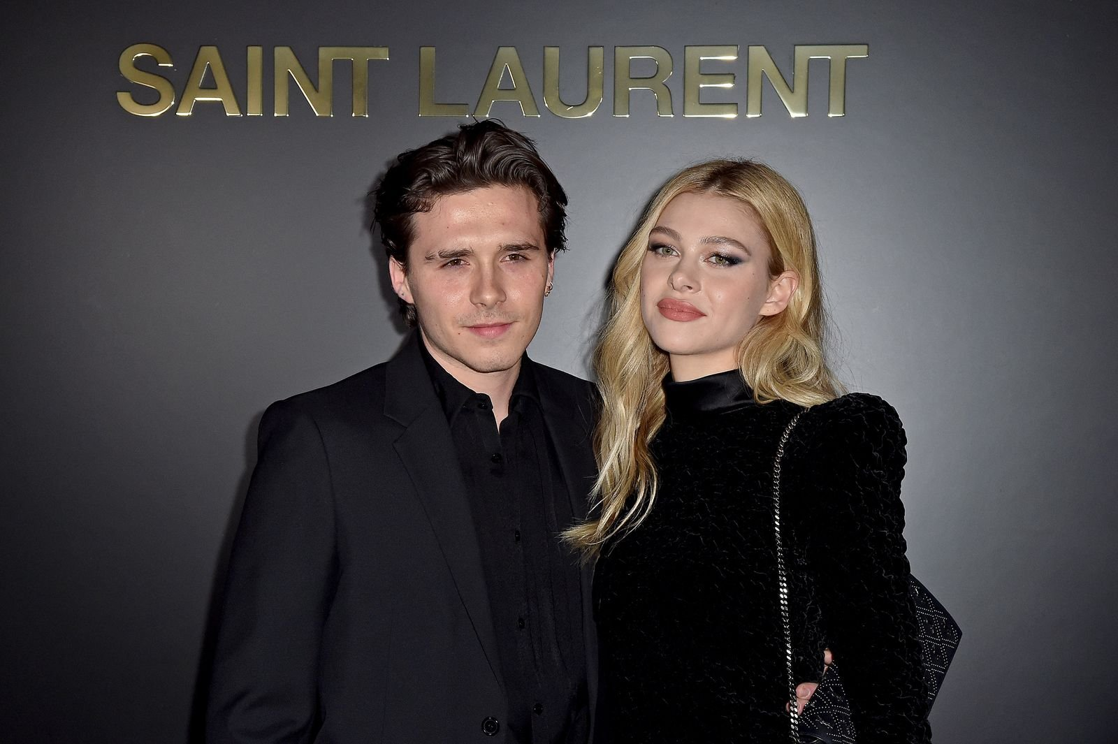 Brooklyn Beckham and Nicola Peltz at a Saint Laurent show for Paris Fashion Week's Womenswear Fall/Winter 2020/2021 on February 25, 2020, in France | Photo: Dominique Charriau/WireImage/Getty Images