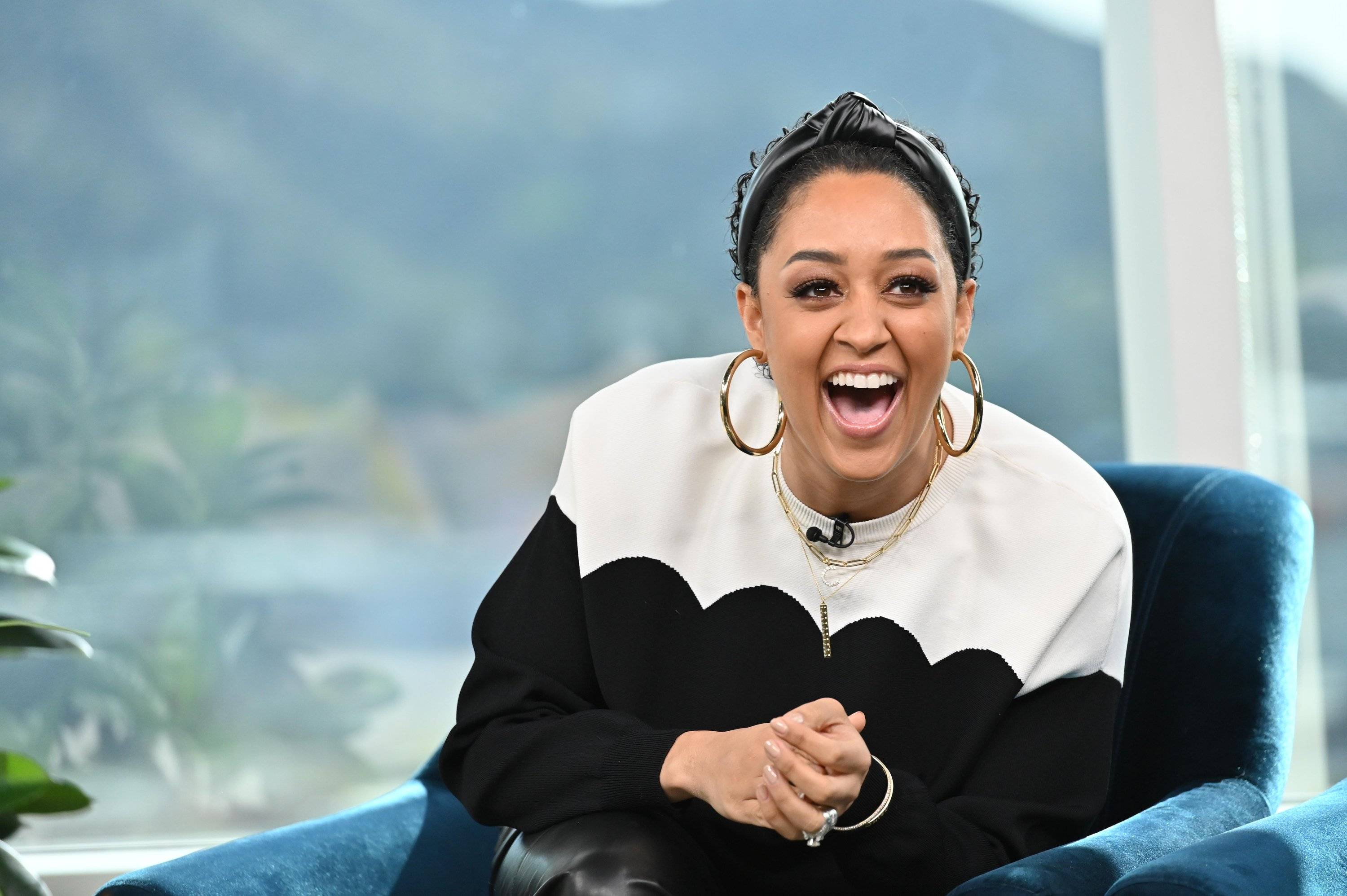 Tia Mowry-Hardrict featured during filming on the set of E!'s Daily Pop.| Source: Getty Images