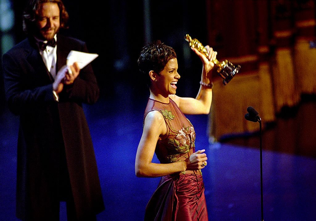"Halle Berry Accepts The Best Actress Academy Award For Her Performance In The Film ""Monster's Ball,"" While Actor Russell Crowe Applauds Her During The 74Th Annual Academy Awards March 24, 2002 At The Kodak Theater In Hollywood, California. 
