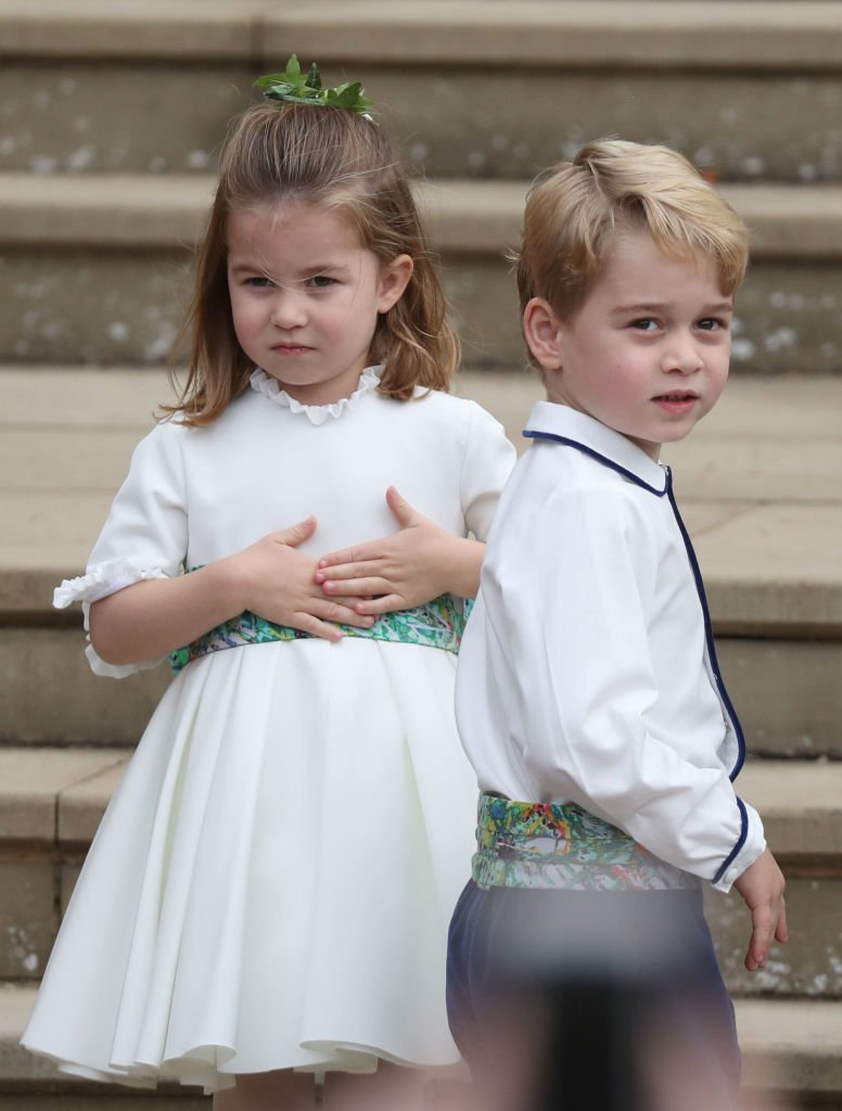 Princess Charlotte of Cambridge and Prince George of Cambridge ahead of the wedding of Princess Eugenie of York and Mr. Jack Brooksbank at St. George's Chapel | Photo: Getty Images