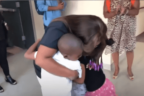 Candace Hall in a warm embrace with her kids | Photo: YouTube/Good Morning America