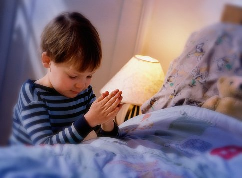 Photo of a young boy praying before going to bed | Photo: Getty Images