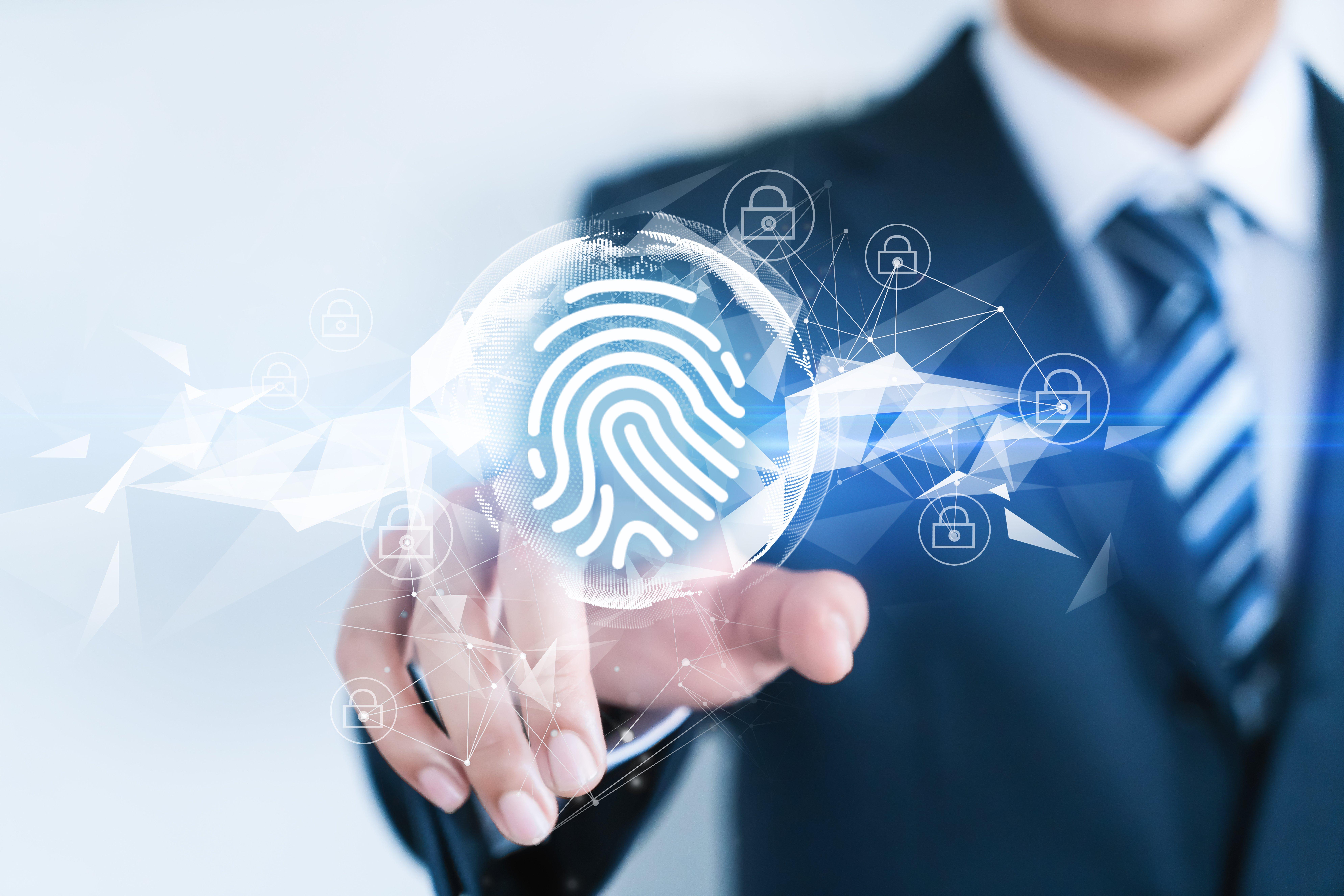 Man pressing a fingerprint button | Photo: Shutterstock