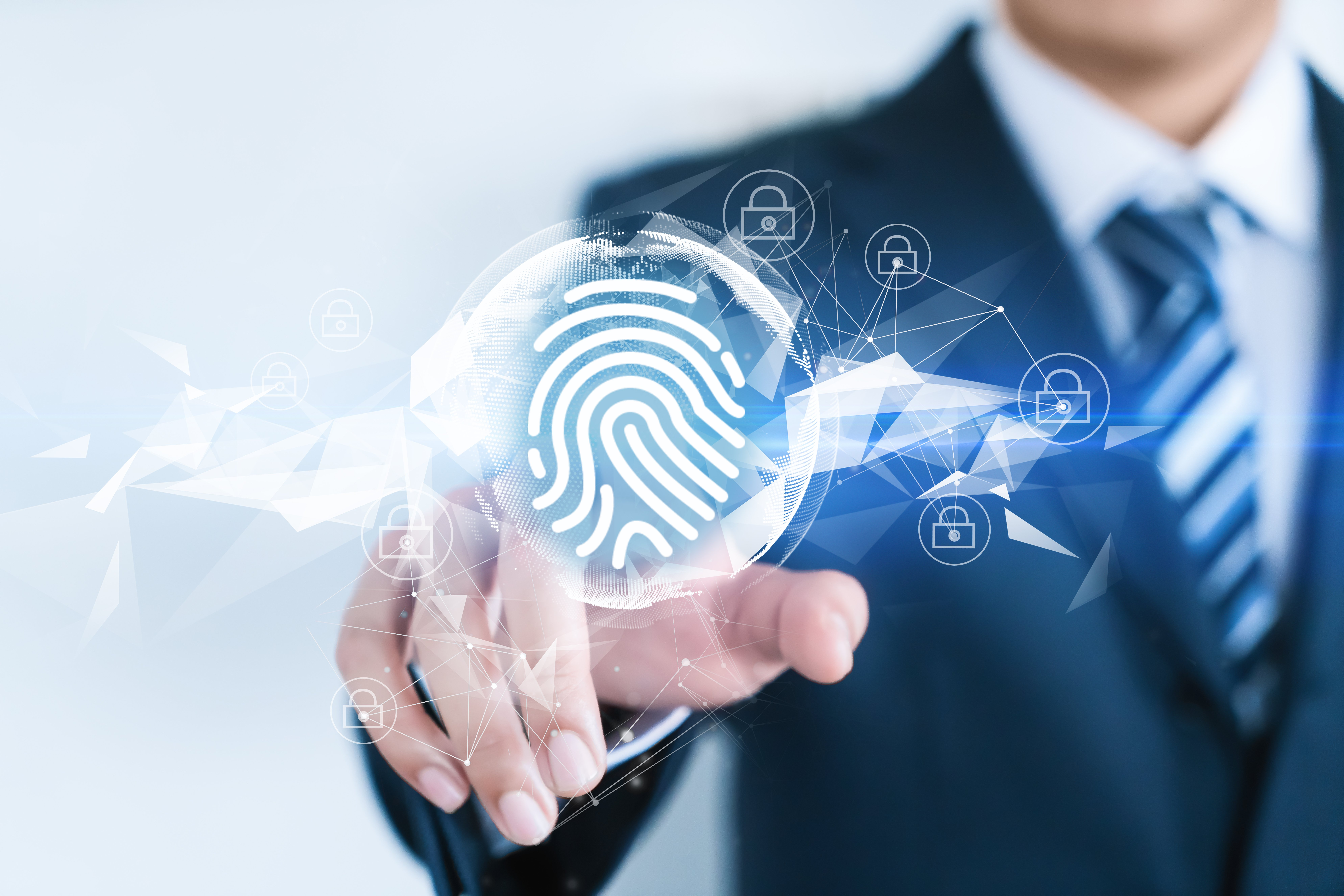 Man pressing a fingerprint button | Photo: Shutterstock