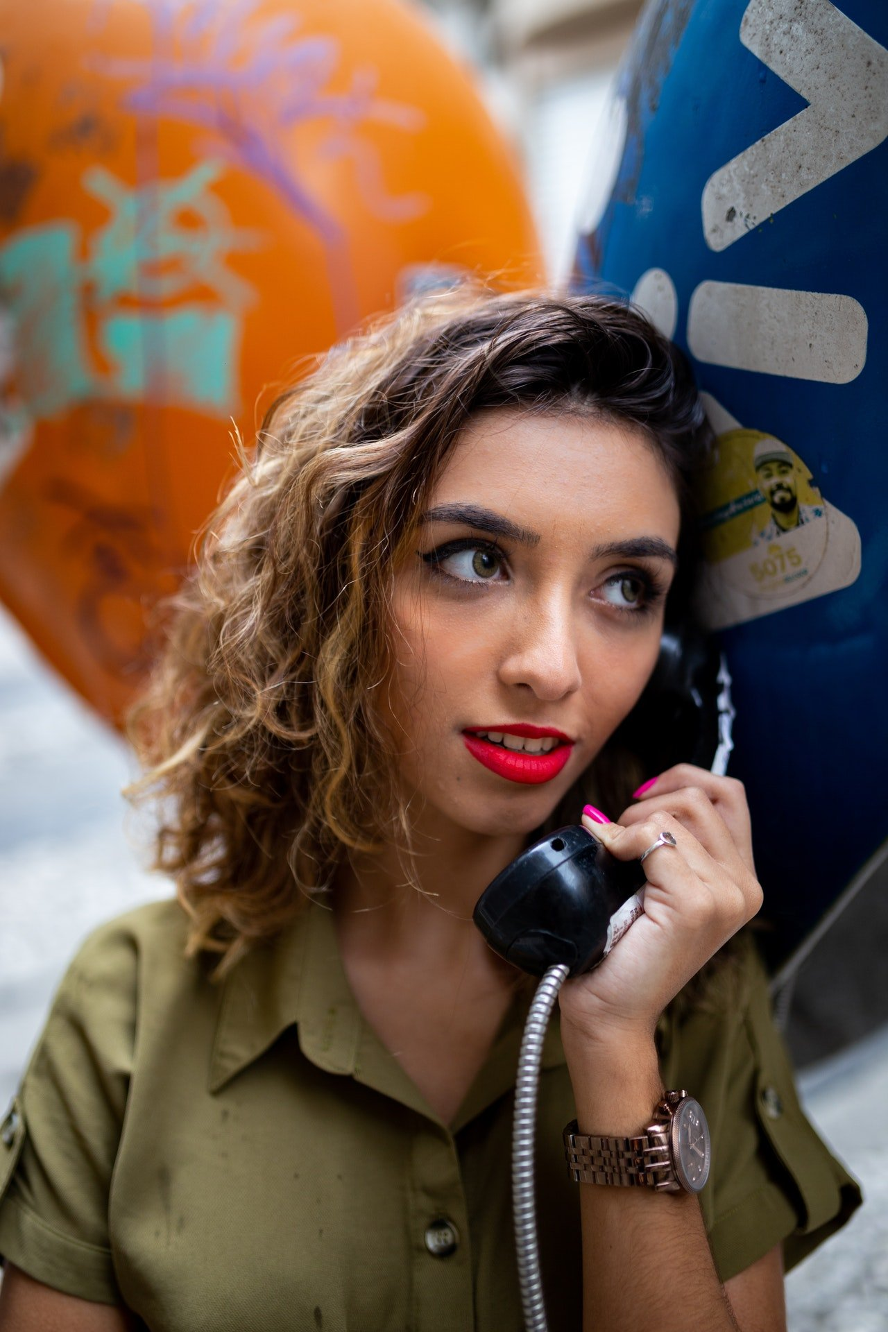 Photo of a woman holding a telephone   Photo: Pexels