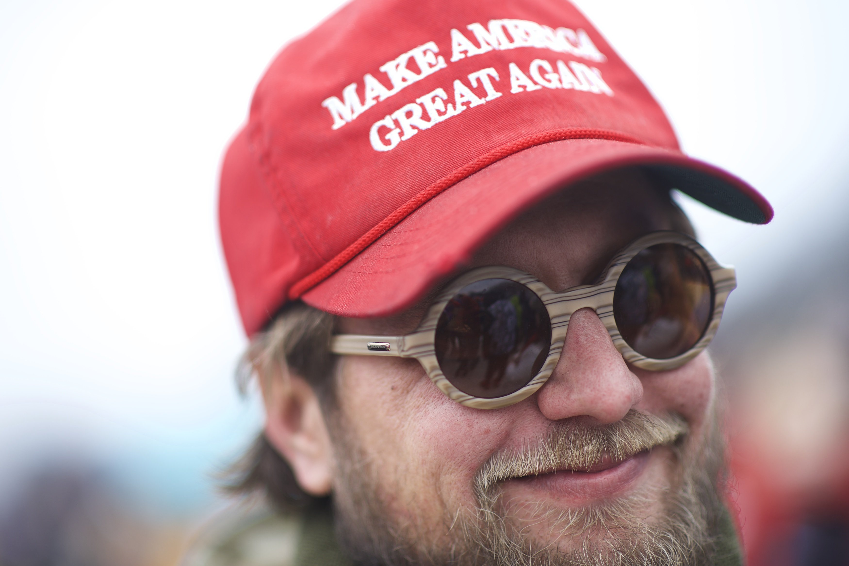 A Trump supporter wearing a MAGA hat | Photo: Getty Images