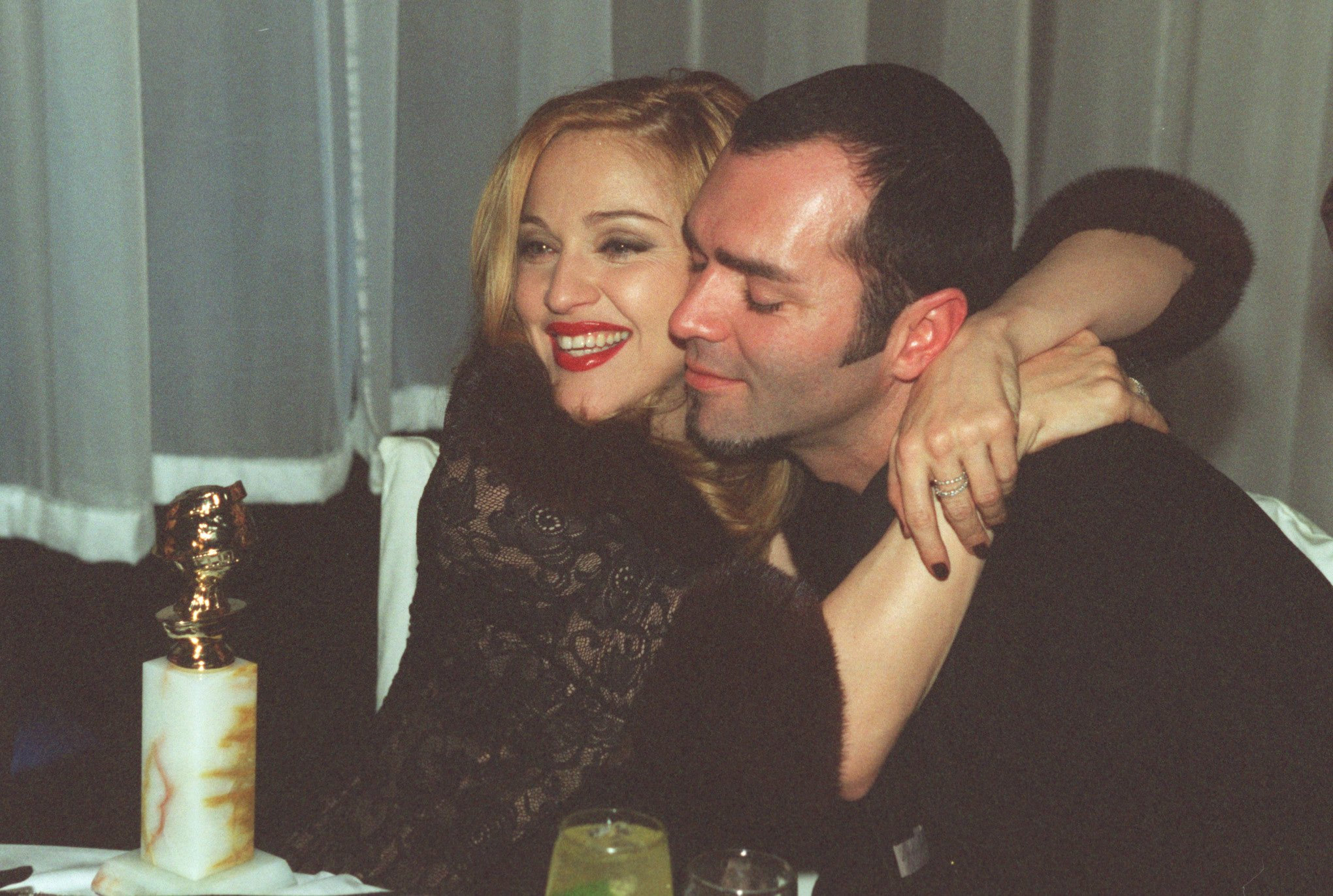 Madonna, winner of Golden Globe for Best Actress in Motion Picture Musical or Comedy with her brother Christopher Ciccone at the Disney party | Photo: Getty Images