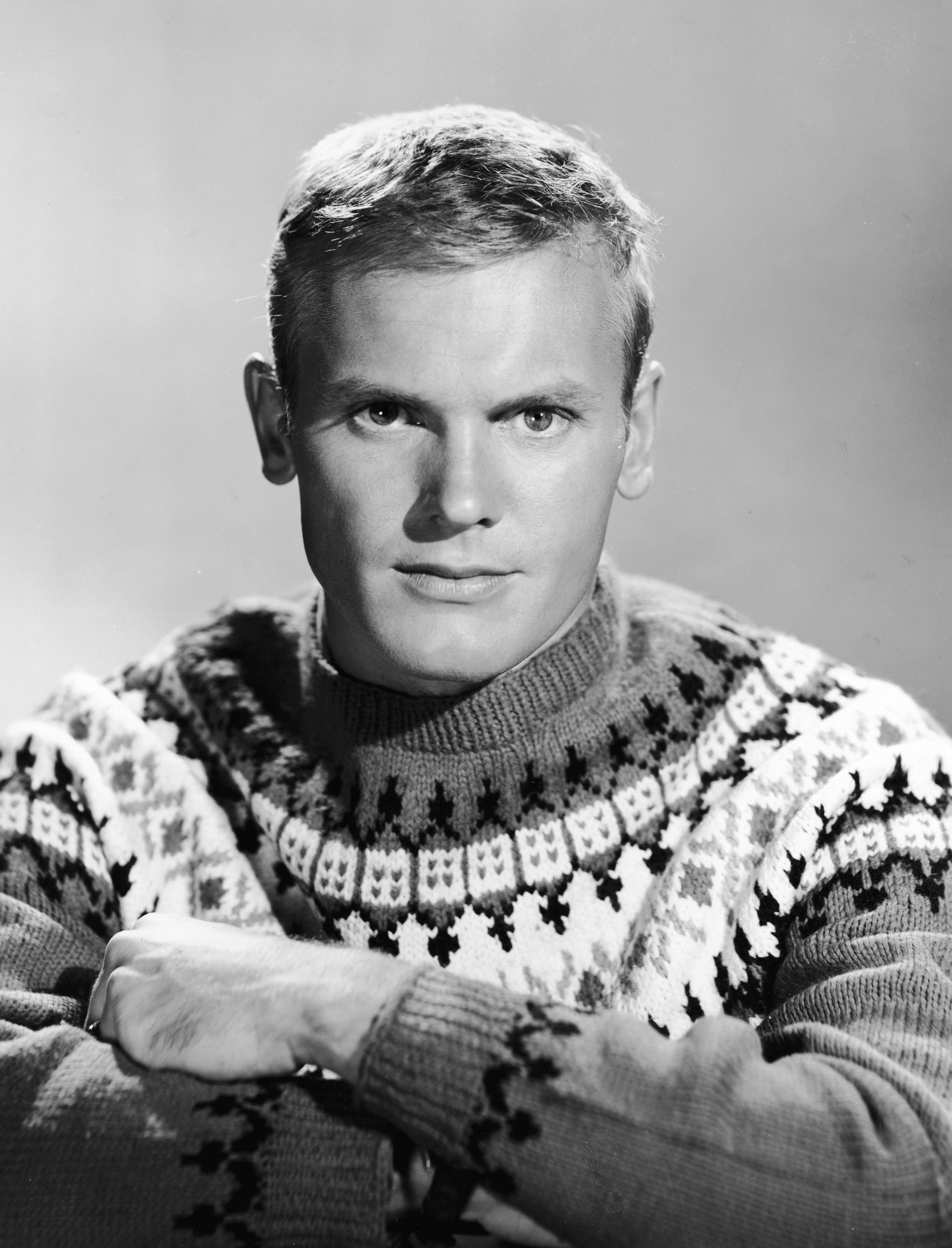 """Tab Hunter wearing a ski sweater in a promotional portrait for """"The Tab Hunter Show"""" in 1960.   Photo: Getty Images"""