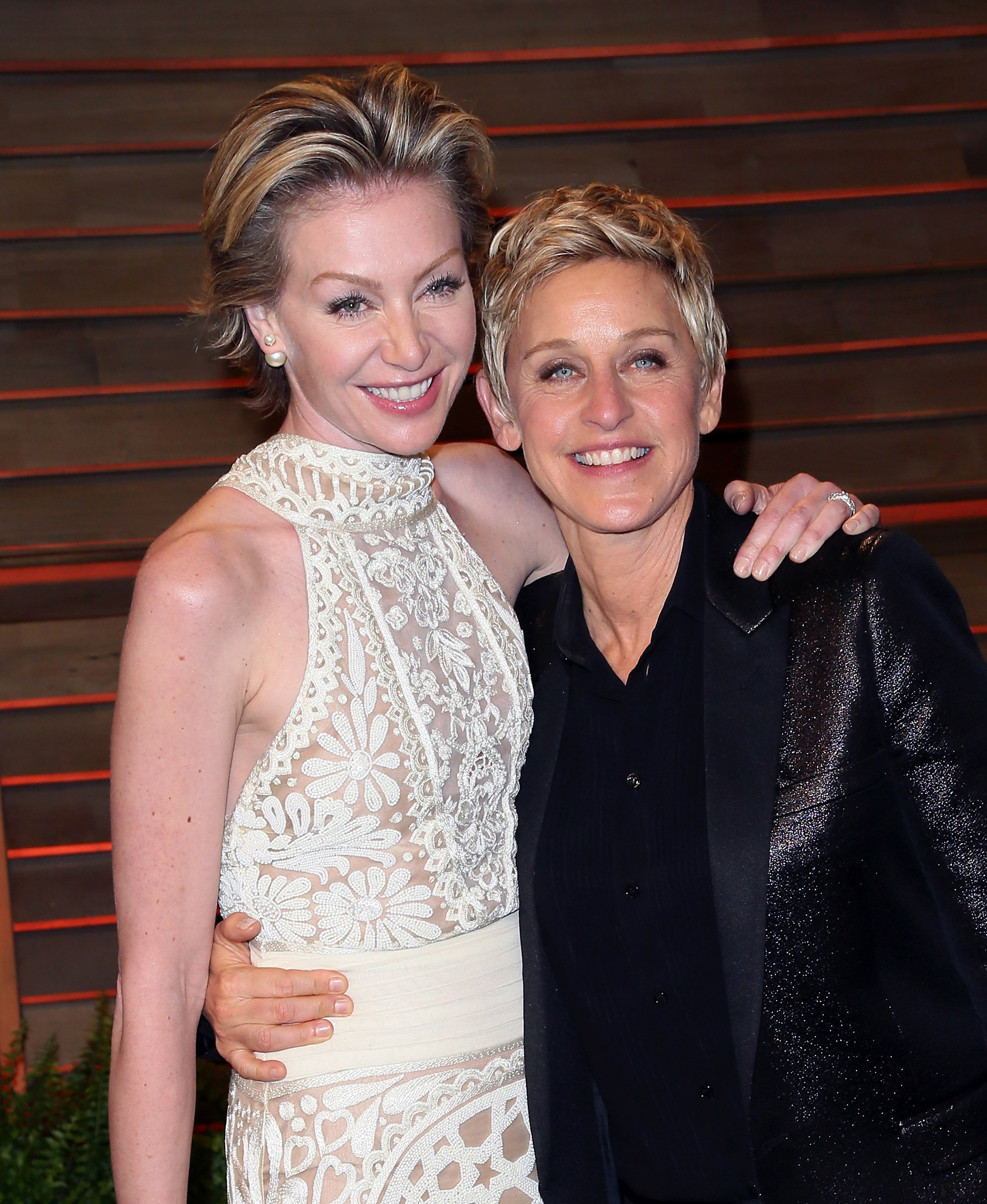 Ellen DeGeneres (R) and spouse actress Portia de Rossi attend the 2014 Vanity Fair Oscar Party hosted by Graydon Carter on March 2, 2014, in West Hollywood, California. | Source: Getty Images.