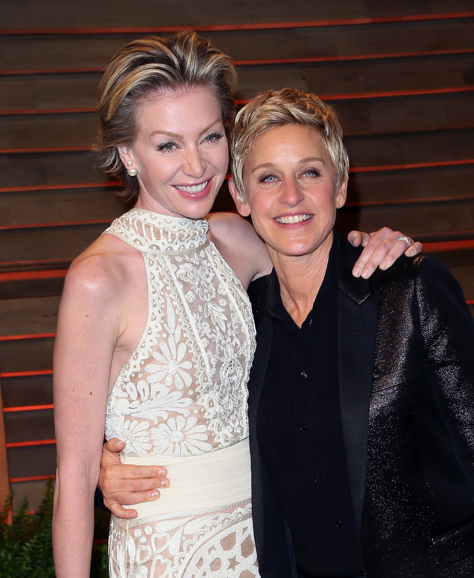 Ellen DeGeneres (R) and spouse actress Portia de Rossi attend the 2014 Vanity Fair Oscar Party  | Getty Images / Global Images Ukraine