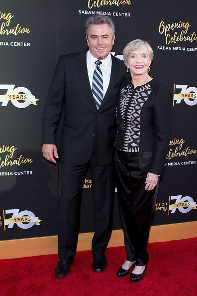 Christopher Knight (L) and Florence Henderson arrive to the Television Academy's 70th Anniversary Gala on June 2, 2016 in Los Angeles, California | Photo: Getty Images