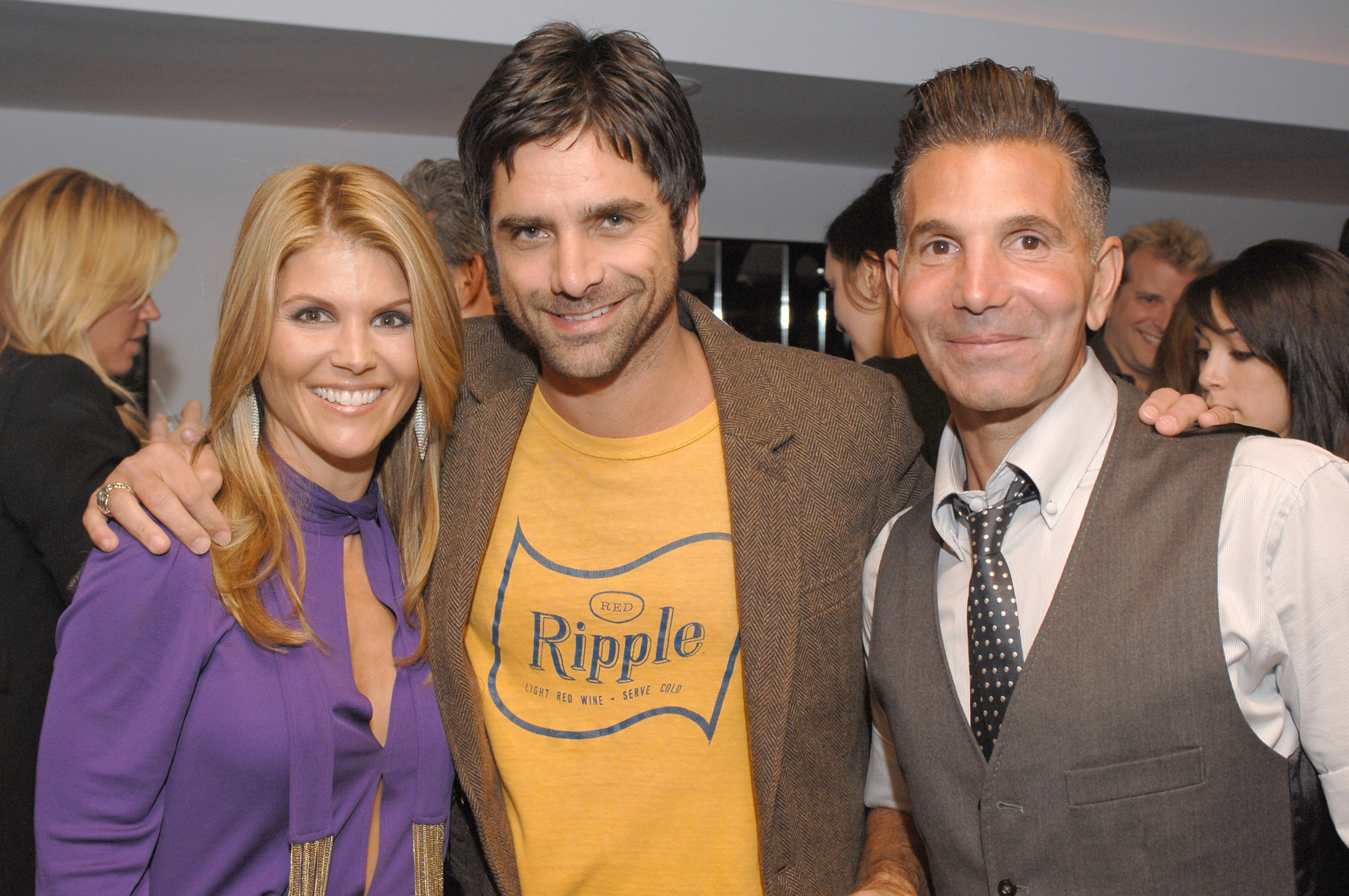 Lori Loughlin, John Stamos, and Mossimo Giannulli at a Target fashion party held in Giannulli's honor, October, 2006. | Photo: Getty Images.