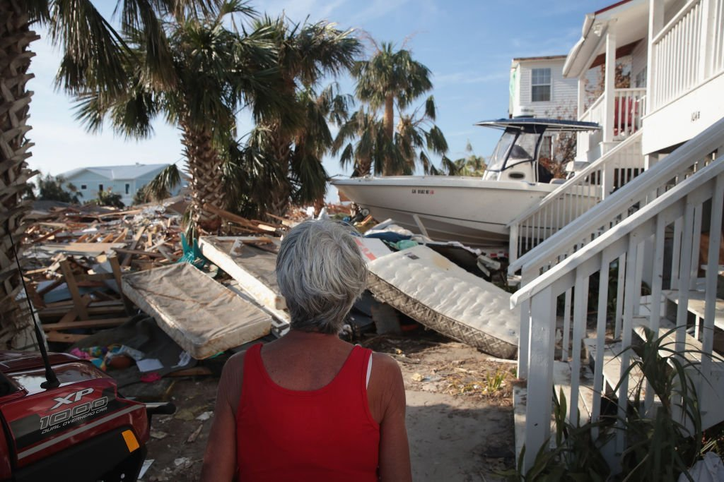 LeClaire Bryan, mother of country music artist Luke Bryan, looks over debris piled near her home by Hurricane Michael | Getty Image / Global Images Ukraine