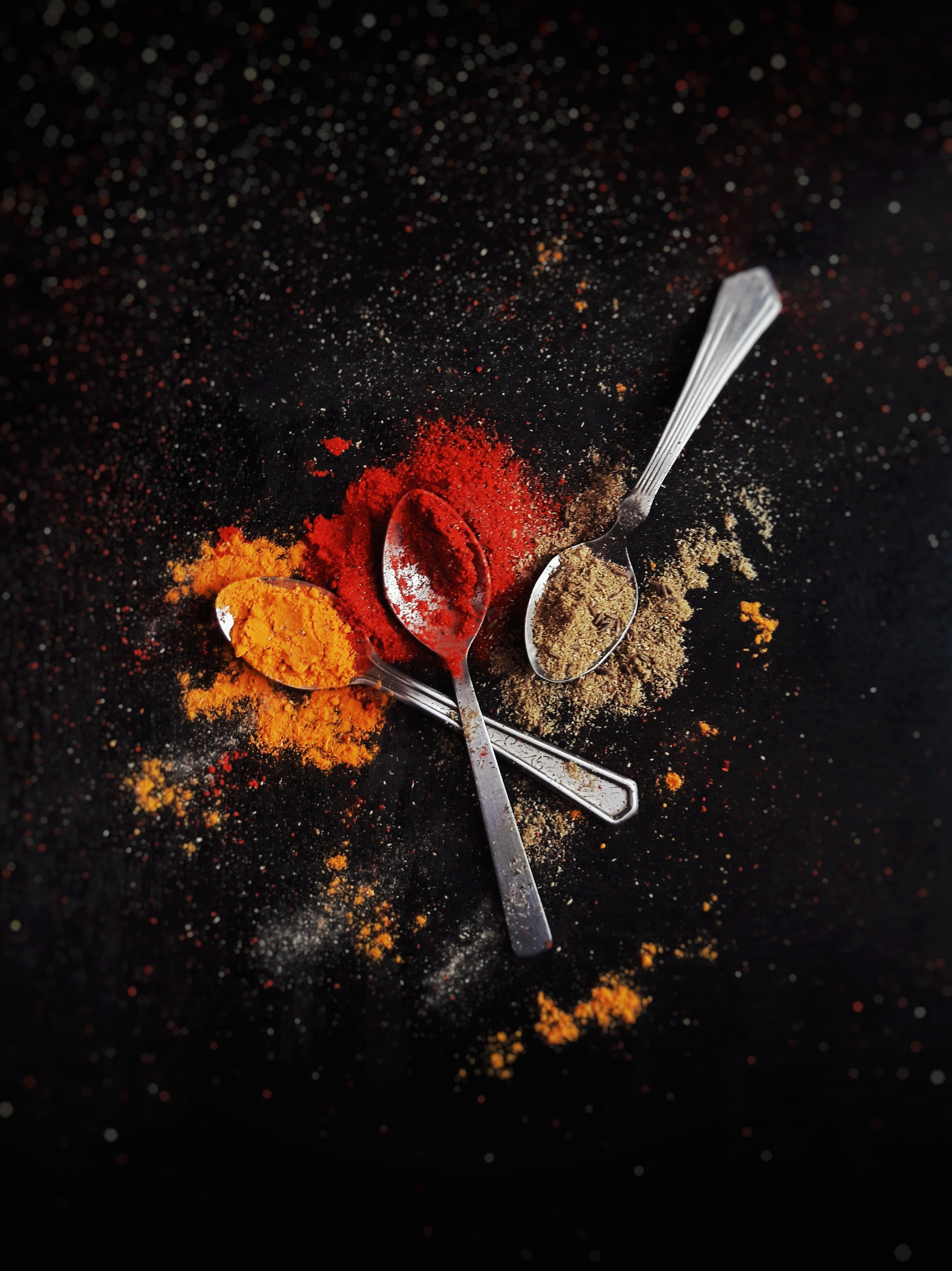 Three spoons with colorful spices.   Pexels
