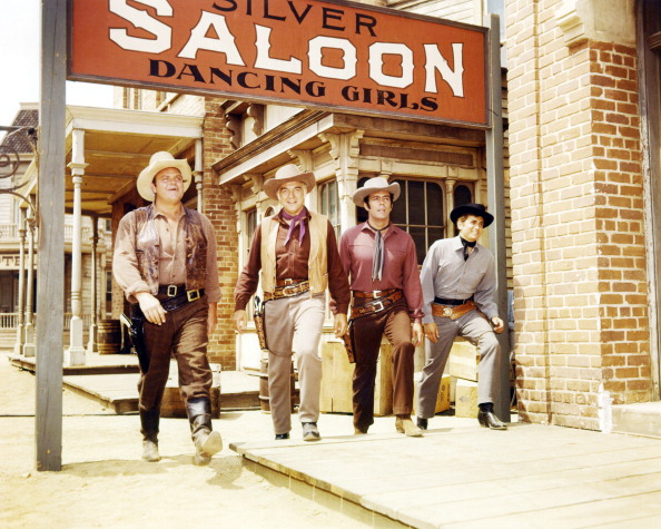 "Actors, Dan Blocker, Lorne Greene, Pernell Roberts and Michael Landon on the set of the famous series, ""Bonanza."" 