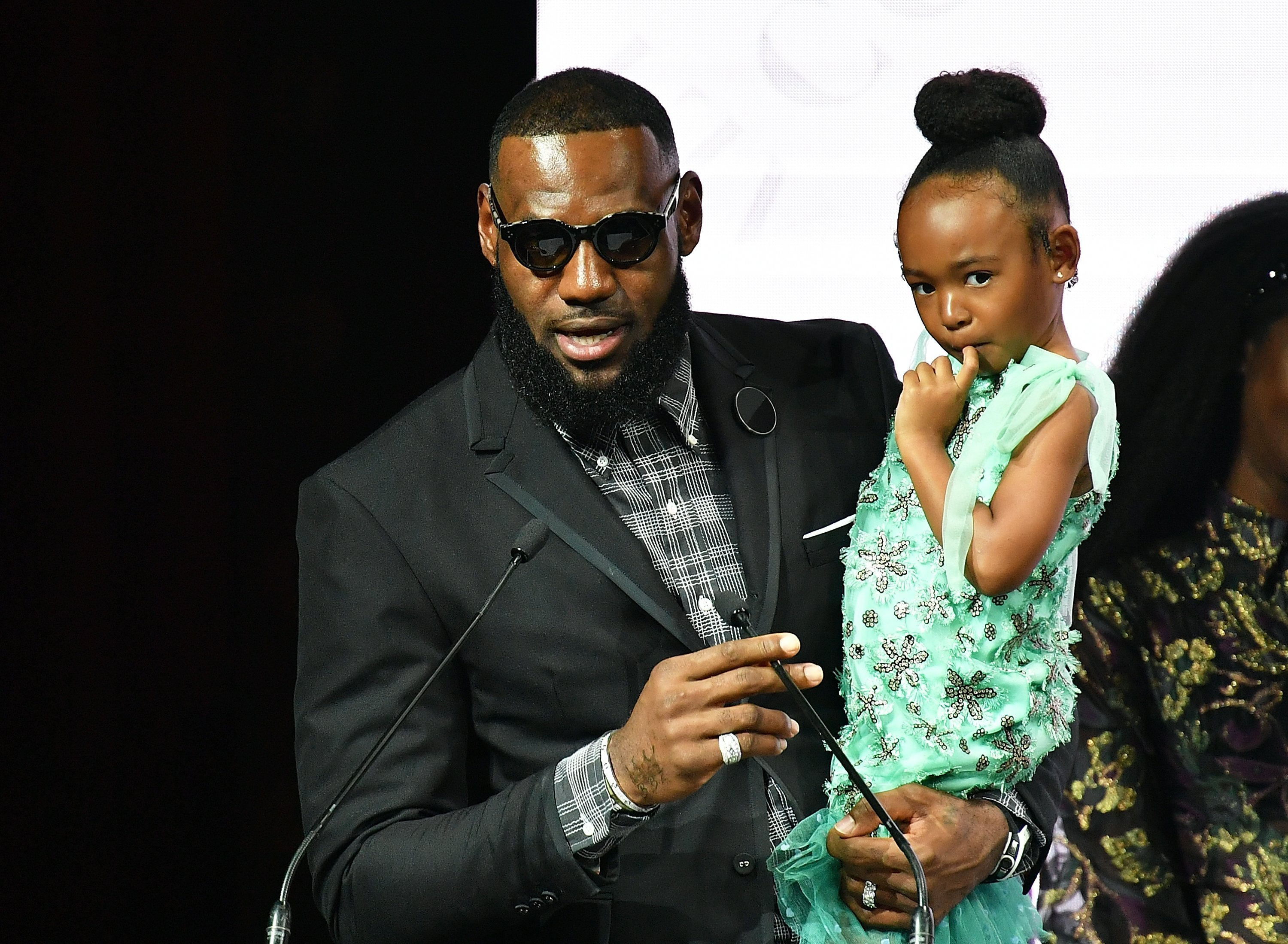 LeBron James, and daughter Zhuri James attend Harlem's Fashion Row during New York Fahion Week | Photo: Getty Image