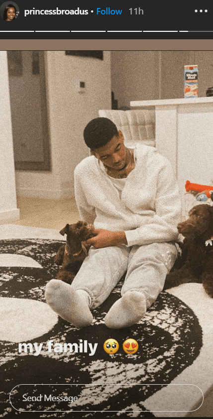 Cori Broadus posted a photo of her boyfriend, Ez, on a rug with her dogs Zayne and Charli | Source: Instagram.com/princessbroadus