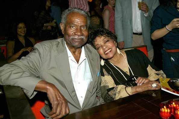 Activist Ossie Davis and actress Ruby Dee posing for a picture at a social gathering | Photo: Getty Images