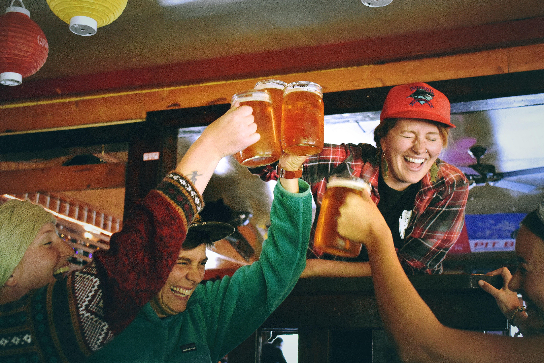 People having fun at a bar.   Source: Drew Farwell/Unsplash