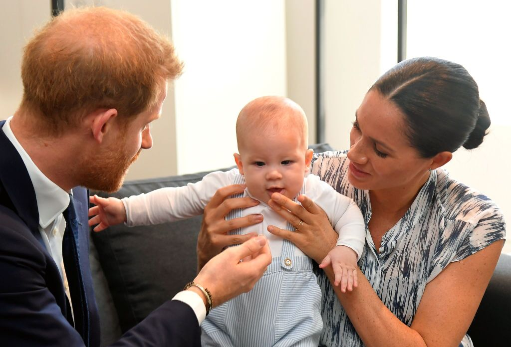 Prince Harry, Duke of Sussex and Meghan, Duchess of Sussex tend to their baby son Archie Mountbatten-Windsor at a meeting with Archbishop Desmond Tutu at the Desmond & Leah Tutu Legacy Foundation during their royal tour of South Africa in Cape Town, South Africa | Photo: Getty Images