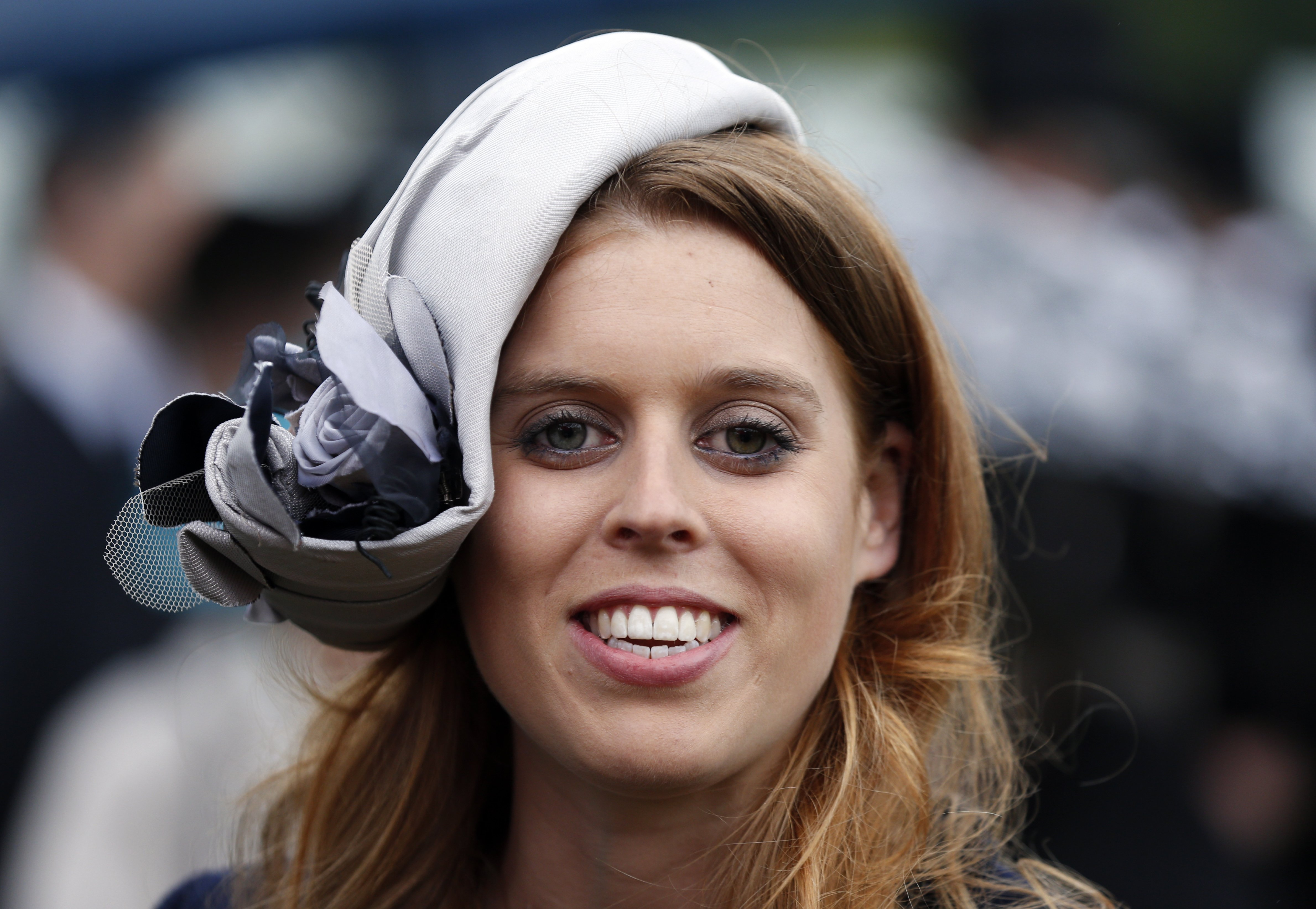 Princess Beatrice smiles during a garden party held at Buckingham Palace, on May 30, 2013 in London, England. | Source: Getty Images