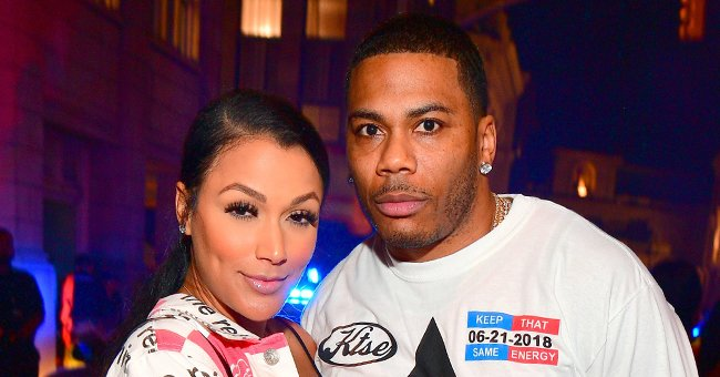 Nelly's Grilfriend Shantel Jackson Stuns in a White Sweater & Skirt Paired with Thigh-High Boots