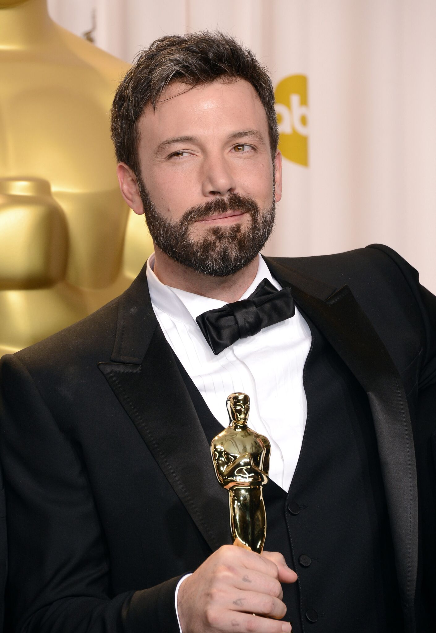 "Ben Affleck, winner of the Best Picture award for ""Argo,"" poses in the press room during the Oscars 