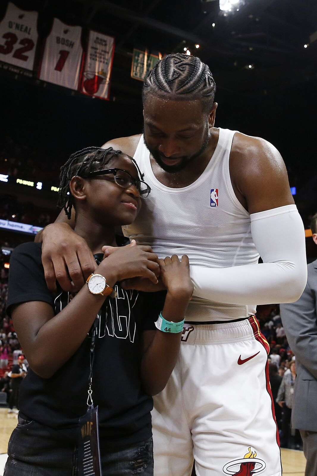 Dwyane Wade hugs daughter Zaya Wade at American Airlines Arena on April 09, 2019, in Miami, Florida | Photo: Michael Reaves/Getty Images