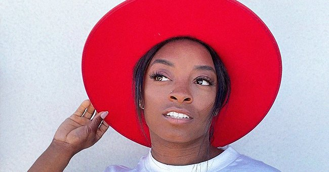 Simone Biles Looks Stunning Posing in a Stylish Printed T-Shirt with a Red Hat