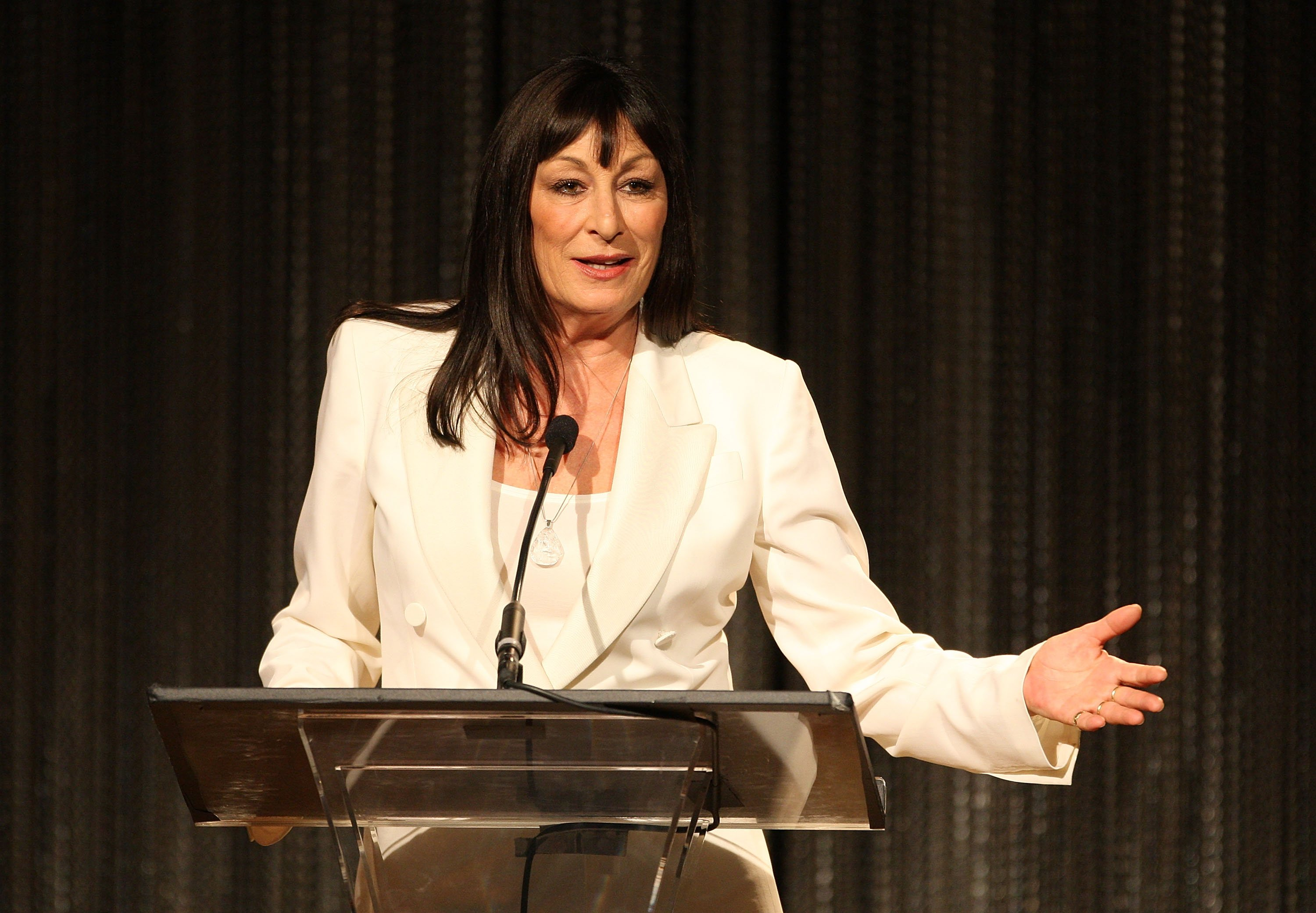 Getty Images l Anjelica Huston gives a speech at the Costume Designers Guild Awards