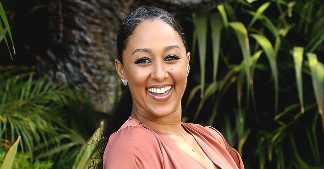 See How Tamera Mowry's Son Aden Made Rainbows in Their Backyard in a Cool New Summer Photo