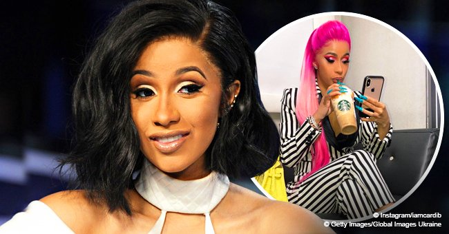 Cardi B shows off pink hair while rocking striped Dolce & Gabbana suit and neon yellow Birkin purse
