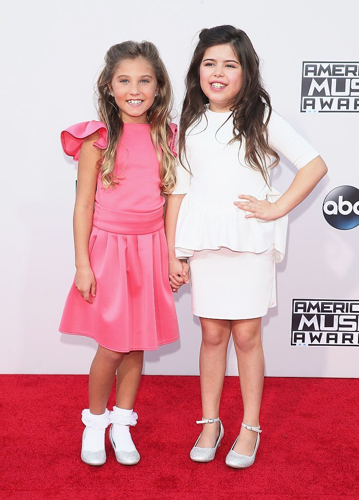 TV personalities Rosie Grace and Sophia Grace attend the 2015 American Music Awards at Microsoft Theater | Getty Images / Global Images Ukraine