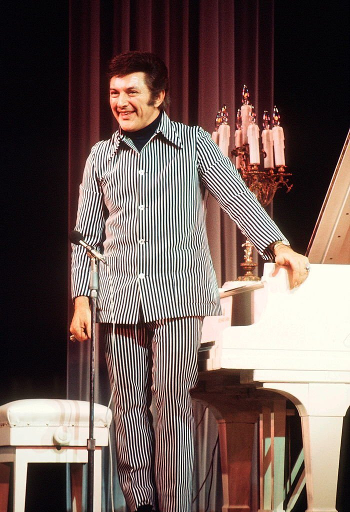 Liberace (1919 - 1987) performs on stage, UK, circa 1983.  | Getty Images