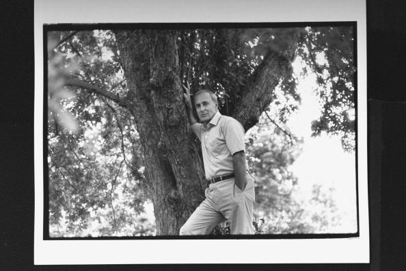 Leo Damore posing against a tree in yard at home, circa 1989. | Photo: Getty Images