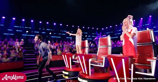 Nervous boy takes the stage alone. Then he sings Celine Dion hit and gets a standing ovation