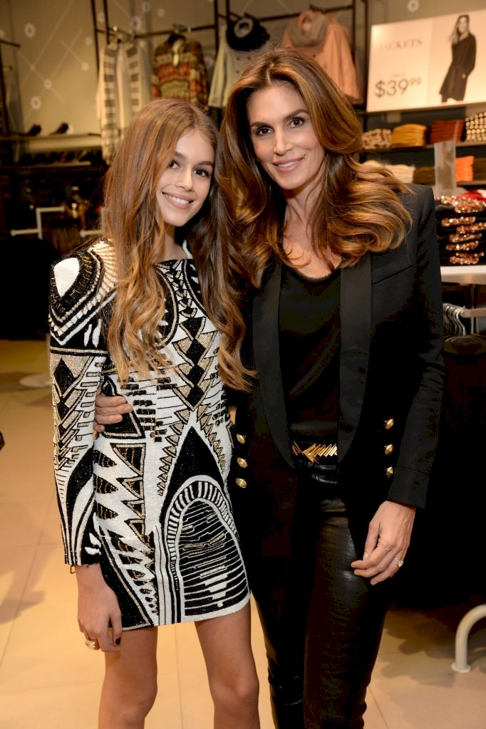 WEST HOLLYWOOD, CA - NOVEMBER 04: Kaia Jordan Gerber (L) and model Cindy Crawford attend the Balmain x H&M Los Angeles VIP Pre-Launch on November 4, 2015 in West Hollywood, California. (Photo by Michael Kovac/Getty Images for H&M)