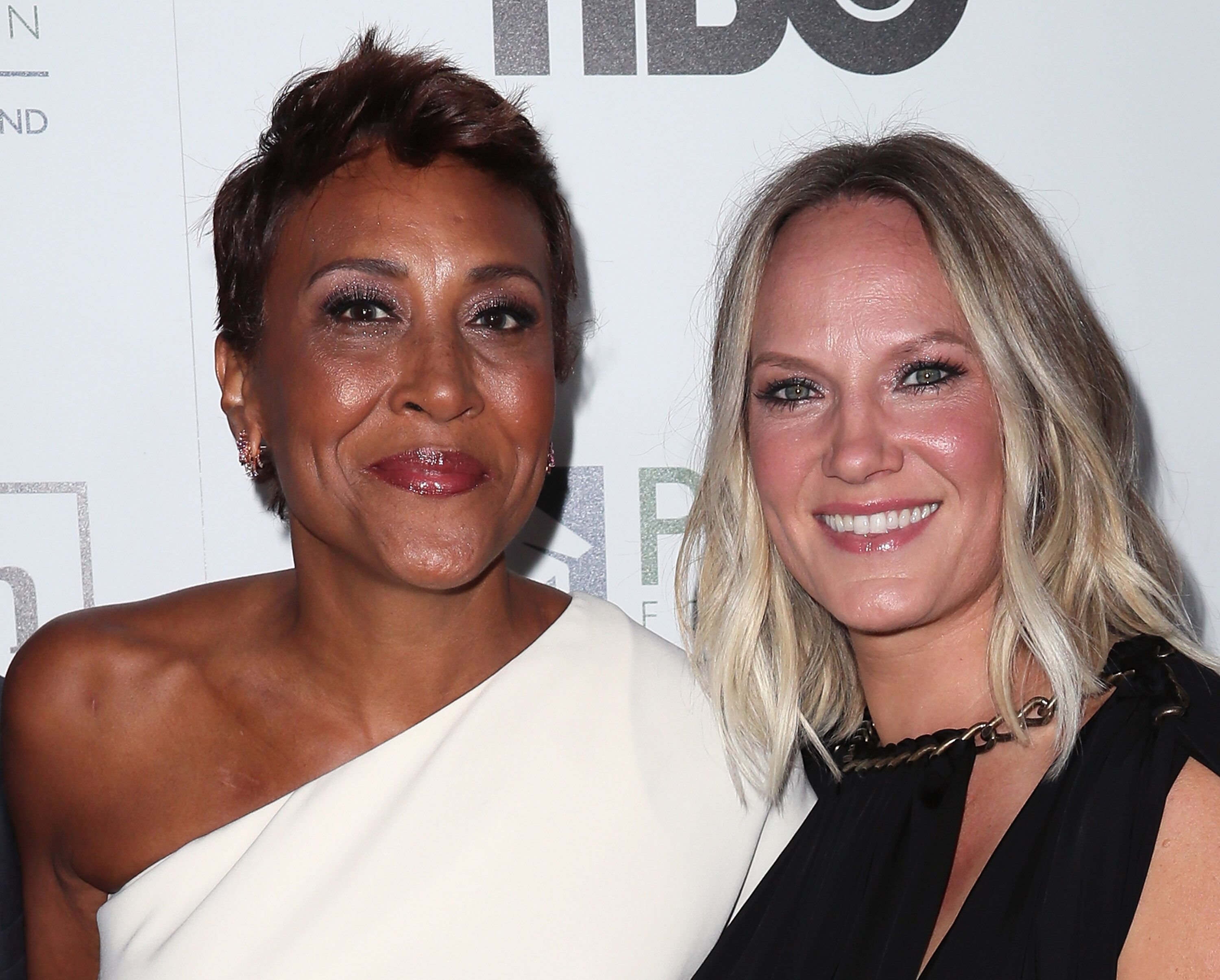 Broadcaster Robin Roberts (L) and partner Amber Laign attend the 2016 Point Honors Los Angeles Gala at The Beverly Hilton Hotel  | Getty Images