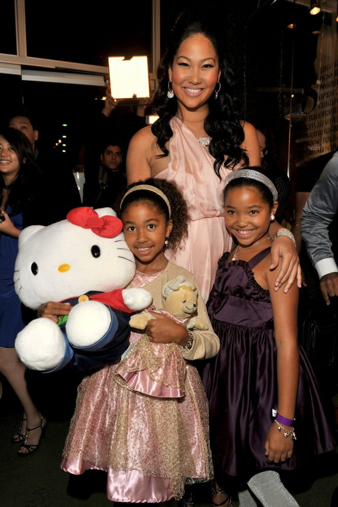 "TV personality Kimora Lee Simmons (C) and daughters arrives at the premiere of Lionsgate's ""The Hunger Games: Catching Fire"" at Nokia Theatre L.A. Live 