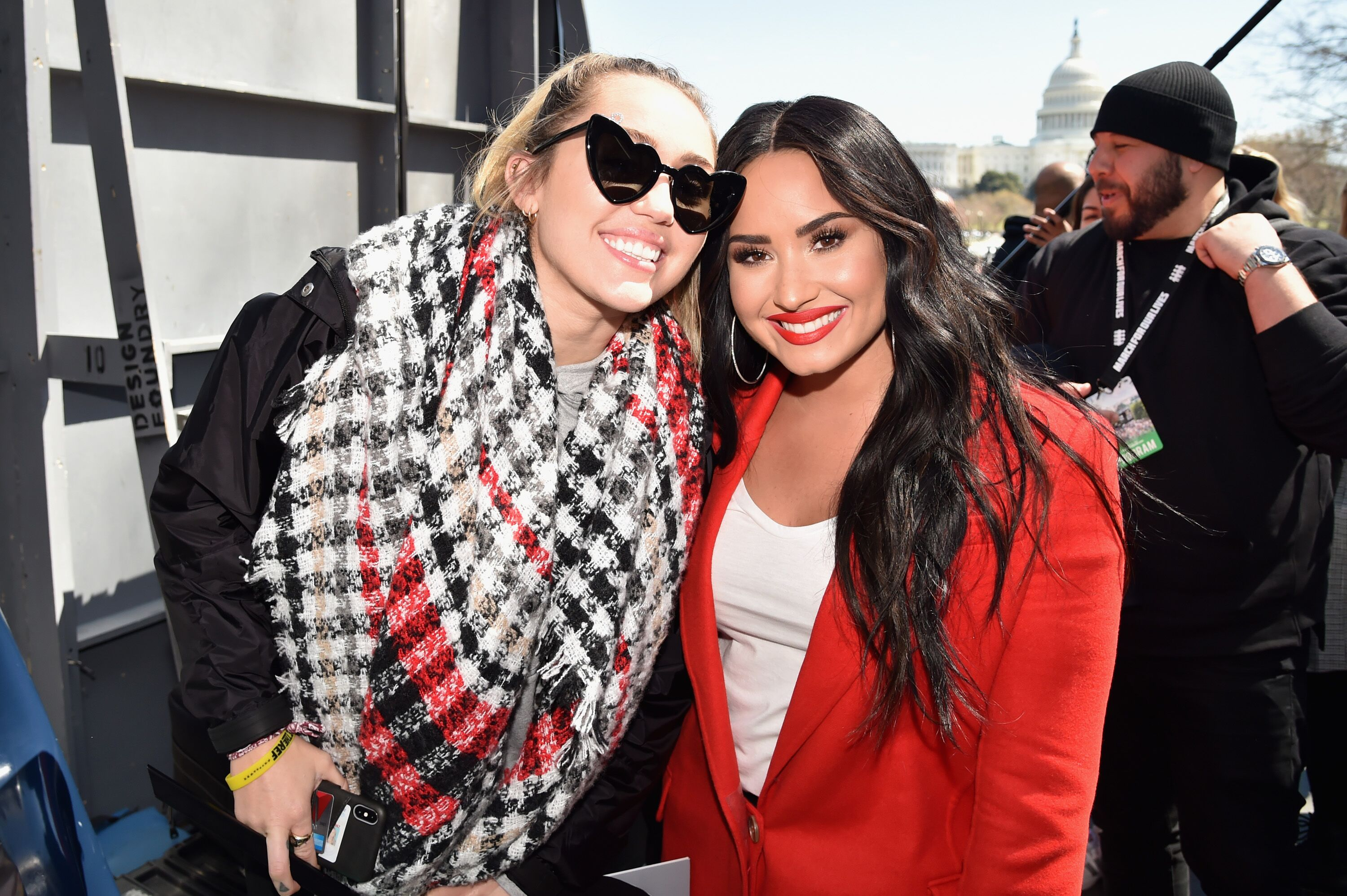 Miley Cyrus and Demi Lovato attend March For Our Lives on March 24, 2018 in Washington, DC. | Source: Getty Images