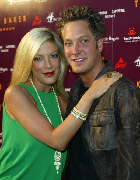 Tori and Randy Spelling pictured at the Ted Baker Los Angeles store opening, 2005. California.   Photo: Getty images.