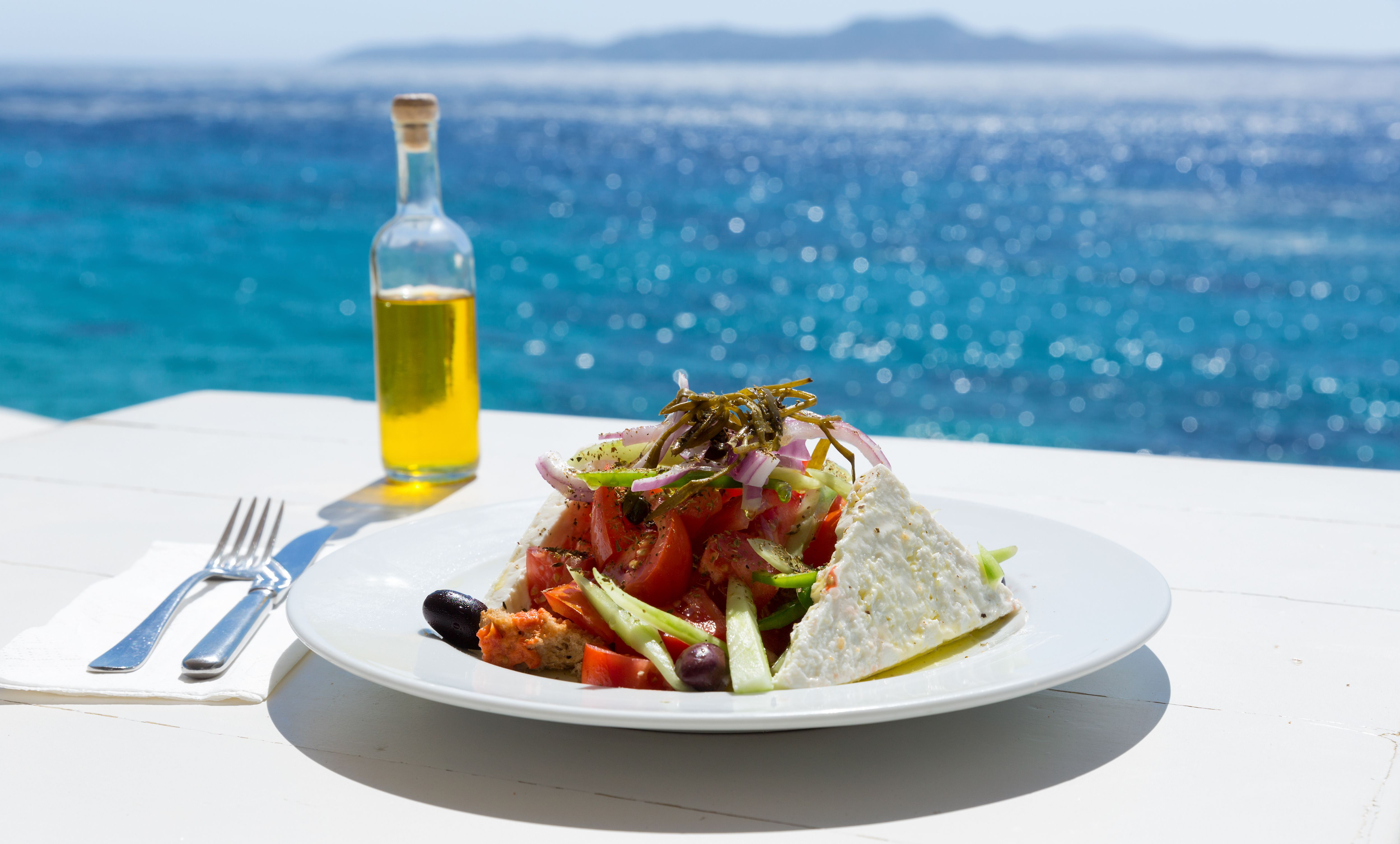 Seafood salad and olive oil by the ocean.   Source: Shutterstock