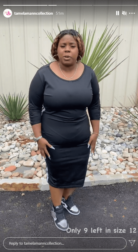 Tia Mann showcases a dress from her mother's clothing brand, Tamela Mann Collection | Photo: Instagram/tamelamanncollection