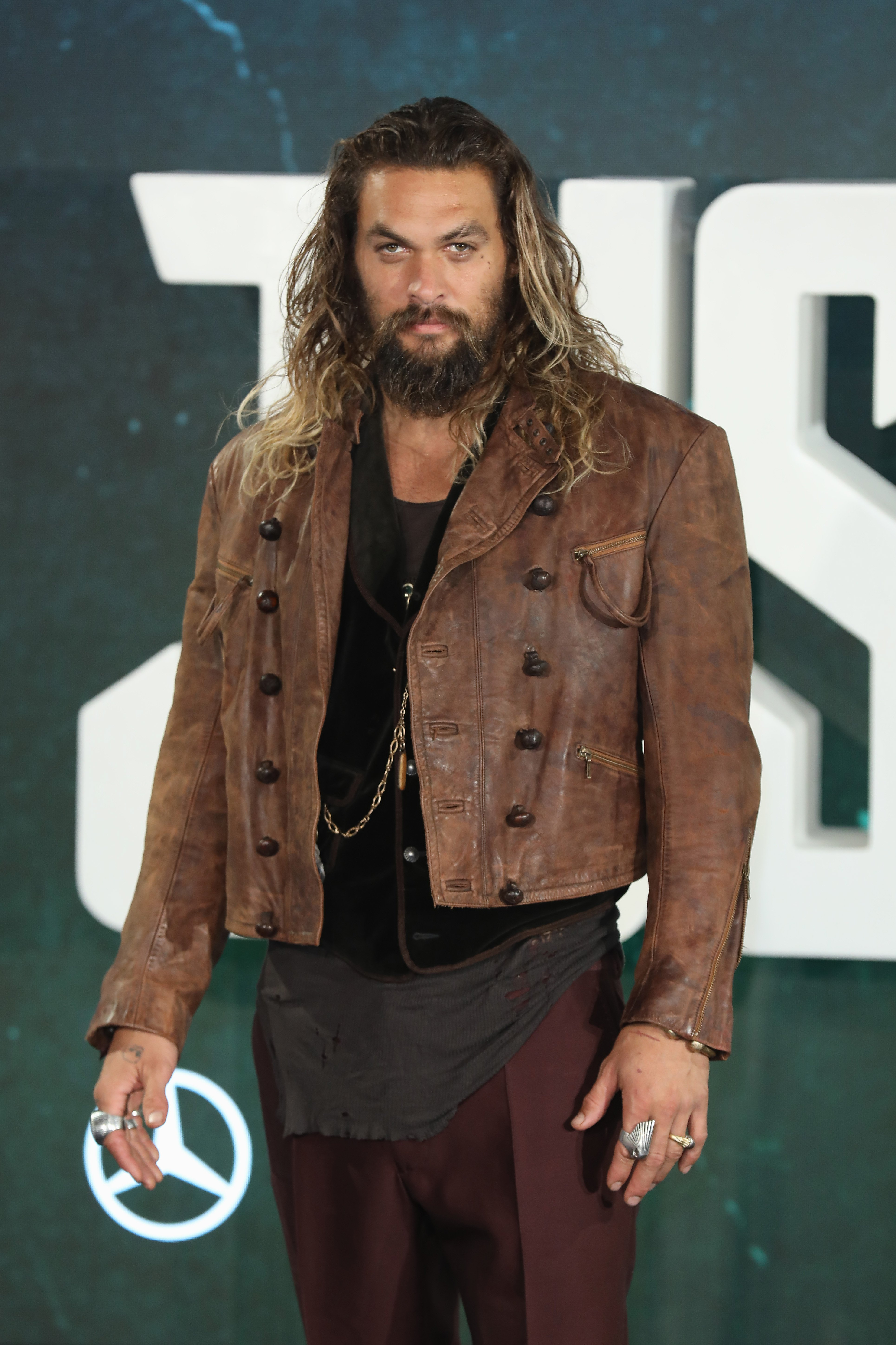 """Jason Momoa attends the photocall for """"Justice League"""" in London, England on November 4, 2017 
